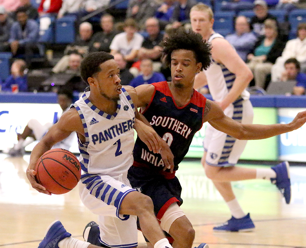 Senior guard Terrell Lewis drives into the lane before passing it back out to Lucas Jones against Southern Indiana Nov. 6 in Lantz Arena. The Panthers are on the road against Western Wednesday.