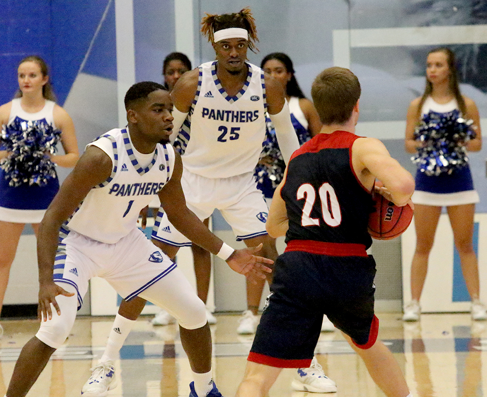 Junior D'Angelo Jackson (front) and senior Muusa Dama (back) guard Southern Indiana's Alex Stein in the Panthers' loss Monday in Lantz Arena. Eastern opens its regular season on the road at Nebraska.