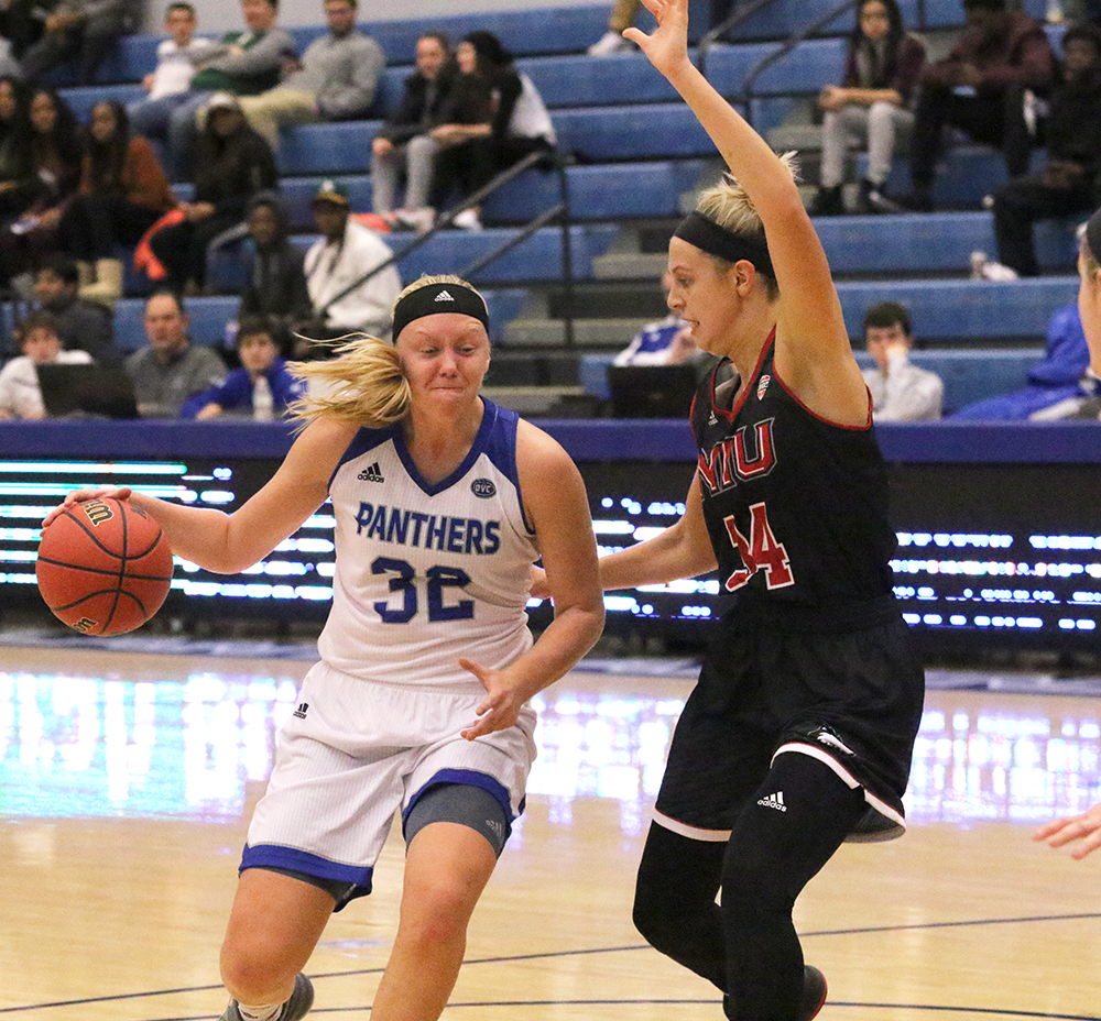 Eastern foward Jennifer Nehls drives the basket in a game against Northern Illinois at Lantz Arena Nov. 10. Nehls scored eight points and snagged four rbounds in the Panthers season-opening loss.