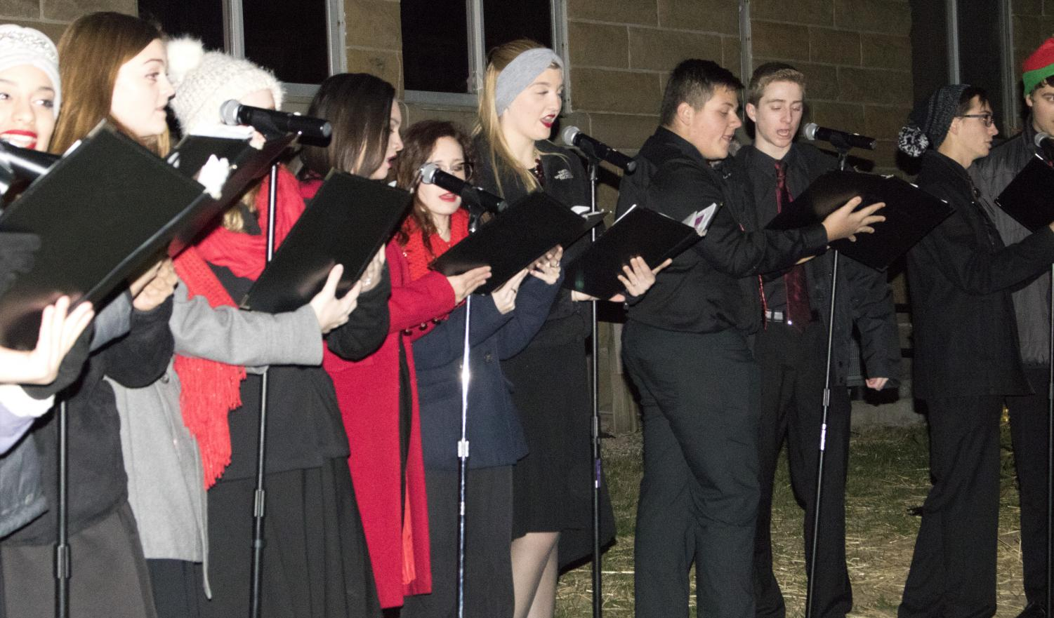 Members of the Charleston High School Choir Maxinum Forte sing for the audience at Christmas in the Heart of Charelston Saturday night.