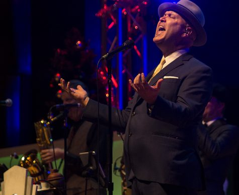 "Scotty Morris, the lead singer and founder of Big Bad Voodoo Daddy, sings the last song of the night during the band's Holiday Concert Tuesday night in the Doudna Fine Arts Center's Dvorak Concert Hall. Even before the band was created, Morris said he started making music and records as young as 7 years old and touring and making punk rock music in studios when he was 15 years old in the early 80s. ""I didn't care if I got paid,"" Morris said."
