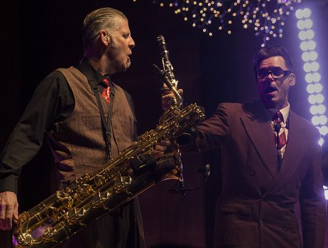 Andy Rowley (left), a member of Big Bad Voodoo Daddy, plays with fellow band member Karl Hunter during one of their sets Wednesday night at the Holiday Concert in the Doudna Fine Arts Center's Dvorak Concert Hall. Rowley plays the baritone saxophone and Hunter plays the saxophone.