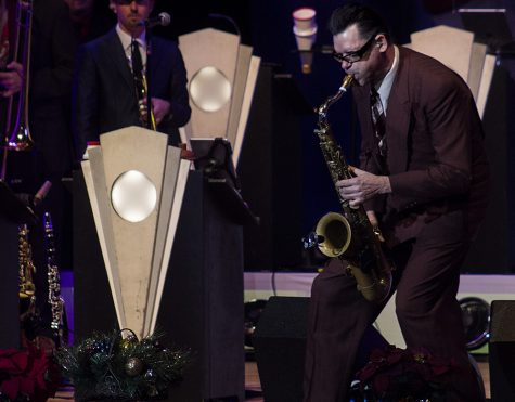 Karl Hunt, a member of Big Bad Voodoo Daddy, plays his saxophone during the band's Holiday Concert Tuesday night in the Doudna Fine Arts Center's Dvorak Concert Hall.