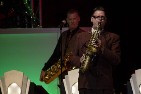 Karl Hunter, a member of Big Bad Voodoo Daddy, plays his saxophone Tuesday night during the band's holiday concert in the Doudna Fine Arts Center Dvorak Concert Hall.