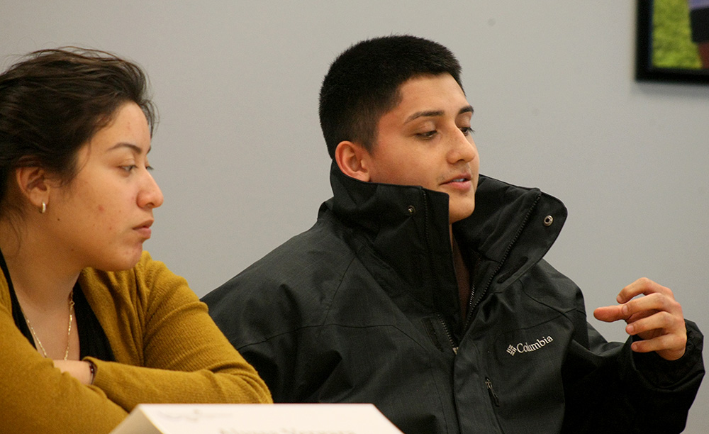 Danny Estrada (right), a student senator and junior sociology major, explains why he nominated Yesenia Muruato, another senator, for Senator of the Semester during the Student Senate meeting Wednesday night in the Arcola/Tuscola Room of the Martin Luther King Jr. University Union. While Alyssa Vergara (left), another senator and sophomore secondary education major looks on, Estrada said he nominated Muruato because of her hard work.