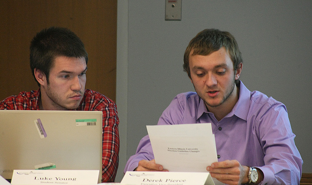 Derek Pierce (right), the student executive vice president, reads a bylaw revision to the election guidelines Wednesday night during the Student Senate meeting in the Arcola/Tuscola Room of the Martin Luther King Jr. University Union while Luke Young (left), the student body president, looks on.