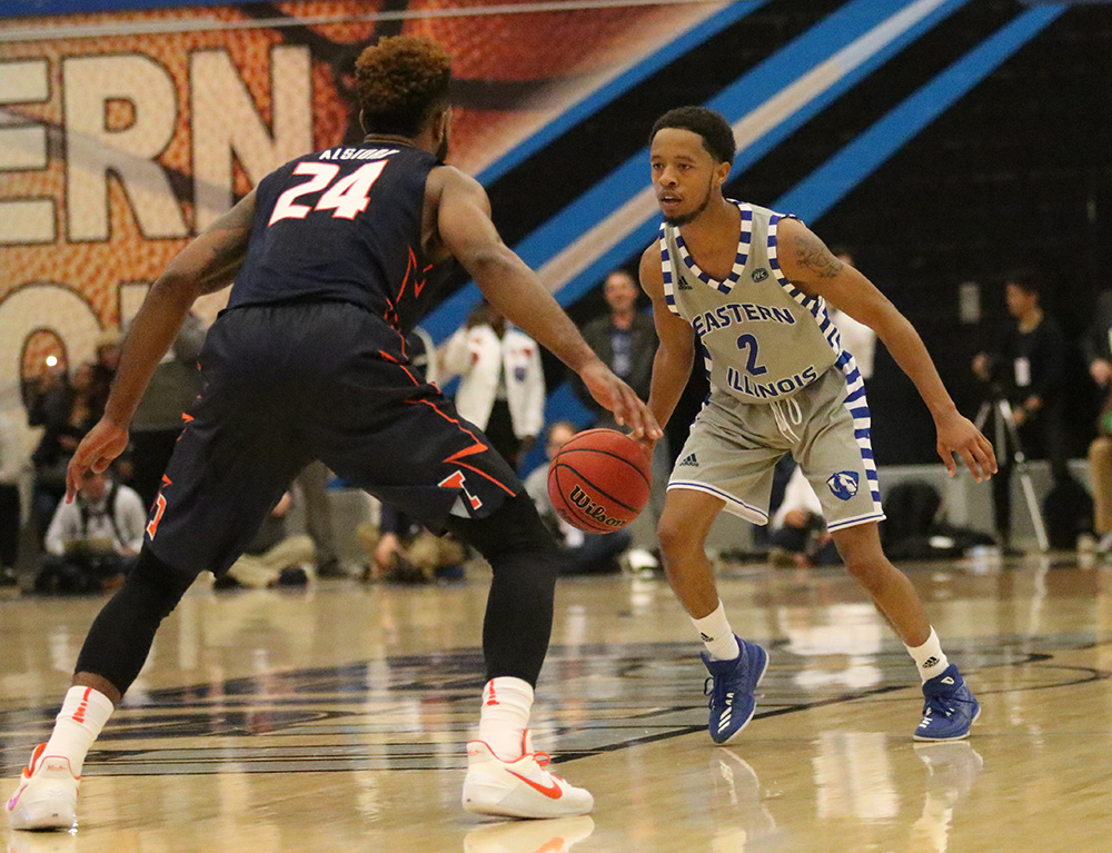 Eastern point guard Tyrell Lewis dribbles the ball in front of an Illinois defender on Nov. 3 at Lantz Arena. Lewis averages nine points per game.