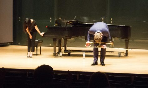 Collaborative Pianist Dr.Kevina Lam and Peter Steiner bow after their performance in the recital hall Tuesday night at the Doudna Fine Arts Center.