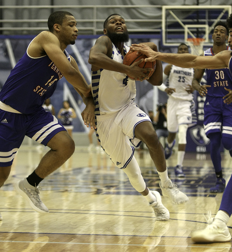 Senior point guard Montell Goodwin drives into the lane against Tennessee State defenders Thursday at Lantz Arena. Goodwin had 17 points in the loss. It was his ninth straight double-digit scoring game.