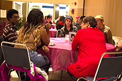 Guests at the Women's March discussion participate in table talk discussions that address their personal experiences regarding feminism and equality in the Martin Luther King Jr. Ball Room on wednesday evening.