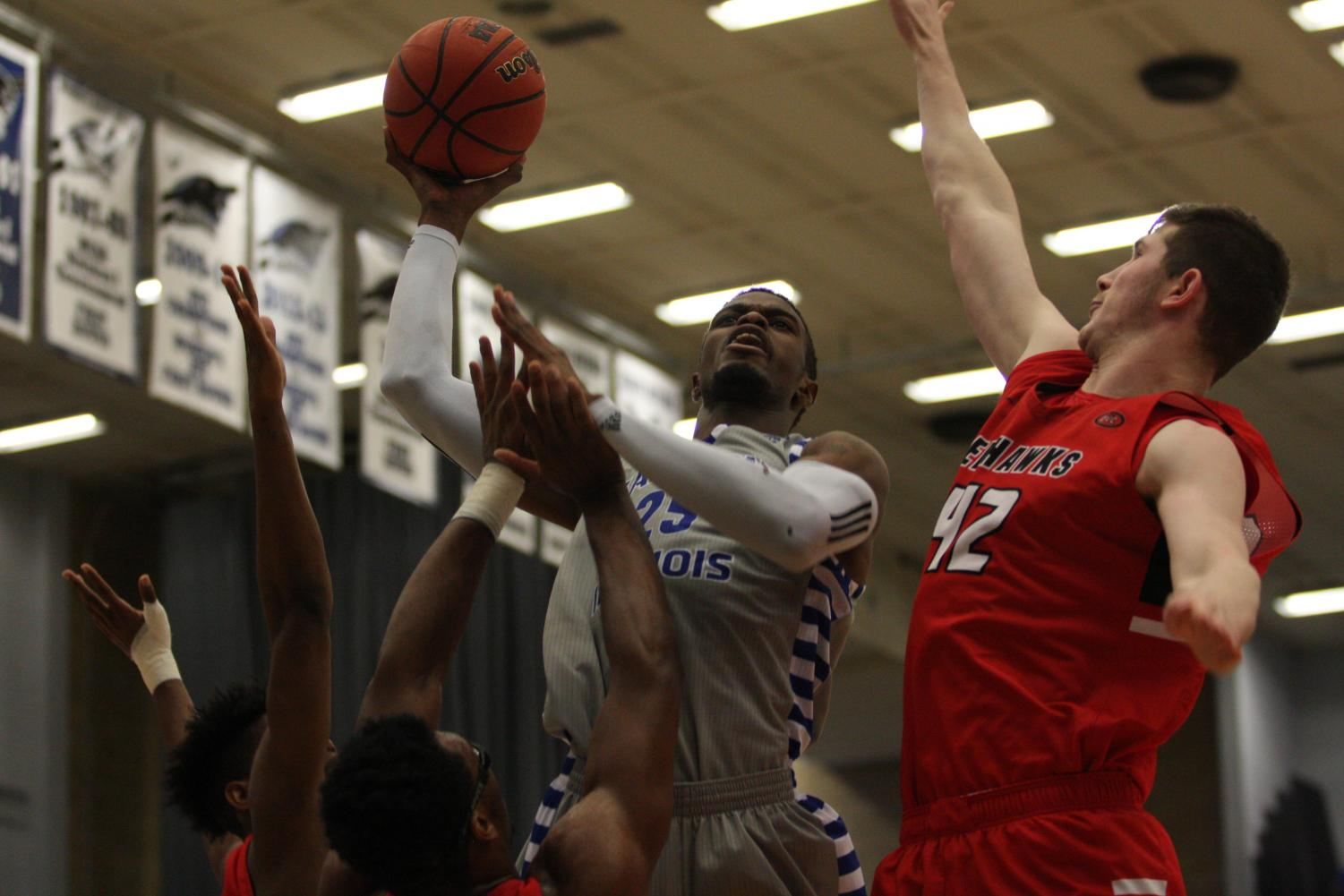 Senior Muusa Dama goes up for a right-hand hook in the Panthers' 86-74 loss to Southeast Missouri Jan. 20 in Lantz Arena. Eastern lost to Belmont 81-59 Thursday on the road.