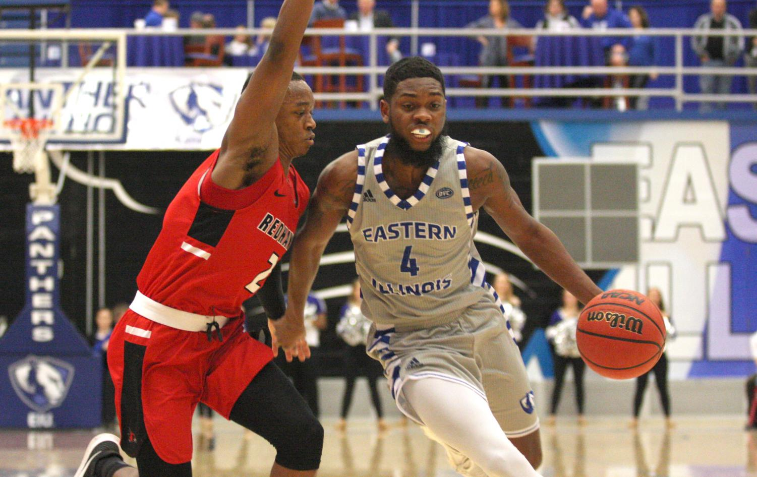 Eastern senior Montell Goodwin dribbles around a Southeast Missouri defender in the Panthers 86-74 loss to the Redhawks Saturday at Lantz Arena. Goodwin scored 13 points in the loss.