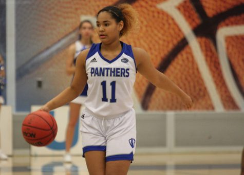 Freshmen Karle Pace dribbles the ball upcourt in Eastern's 72-44 loss against Tennessee-Martin at Lantz Arena Thursday. Pace scored five points in the game.