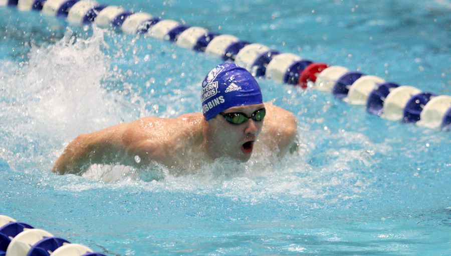 Senior Brandon Robbins swims the men's 100-yard butterfly where he took third at 55.17 Saturday at the Padovan Pool. Eastern's men and women both beat Valparaiso.