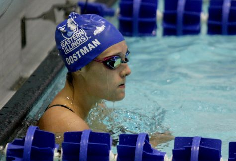 File photo | The Daily Eastern News Junior Lauren Oostman finishes her backstroke race Oct. 28 at Padovan Pool against Western Illinois. Oostman returned back to the pool Saturday at Evansville.