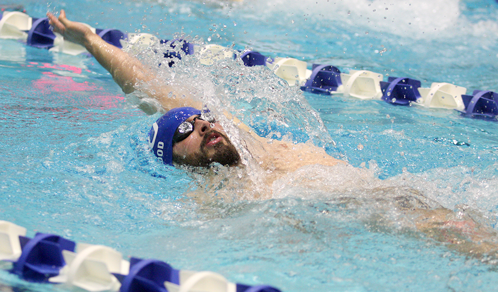Senior Patrick Wood swims the backstroke leg of the men's 200-yard relay Saturday against Valparaiso at the Padovan Pool. He said one thing that has made his senior year fun was being able to be on the team with his younger sister, freshman Lindsey Wood.