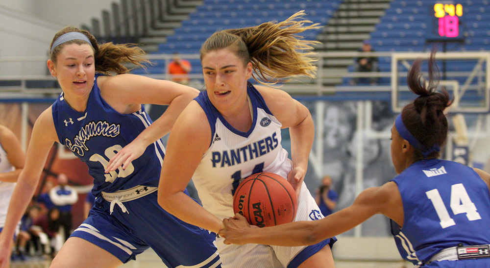 Freshman Grace McRae drives to the basket through two Indiana State defenders in the Panthers' 77-70 win over Indiana State Nov.3 in Lantz Arena. McRae finished with 5 points.
