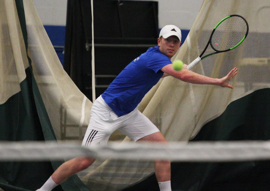 Eastern+sophomore+Freddie+O%E2%80%99Brien+returns+a+ball+at+a+team+practice+in+October.+O%E2%80%99Brien+had+a+4-5+record+in+singles+play+for+the+Panthers+last+season.