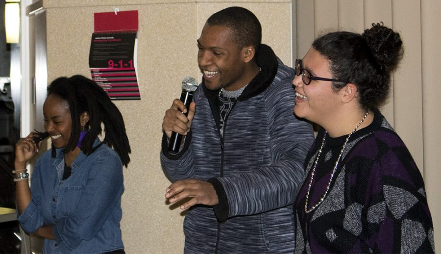 Alleluia Musabyimana, a senior sociology major, Marciall Anthony, an Eastern visitor and Maya Lee, a junior psychology major, laugh with each other at  'Take A Knee'  Thursday night in the University Ballroom of the Martin Luther King Jr. University Union.