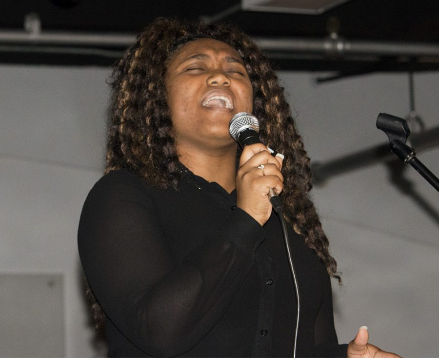Jordan Boyer | The Daily Eastern News Gena Browning a sophomore family consumer science major, sings at 'My Black Is … Empowering Poetry Slam' Monday night at the 7th Street Underground.