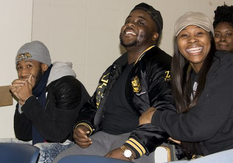 "Kaleb Williams a senior kinesiology major, Elijah Weathers a senior Africana studies major and Deearia Watkins a junior family consumer sciences major, laugh with each other at ""Black Jeopardy"" Tuesday night at Coleman hall."