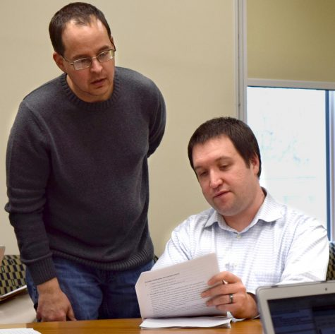 Mathematics and computer sciences professors Grant Lakeland and Peter Wiles, double check the specifics on one of their course revision proposals at the Council on Academic Affairs meeting Thursday afternoon in Booth Library.