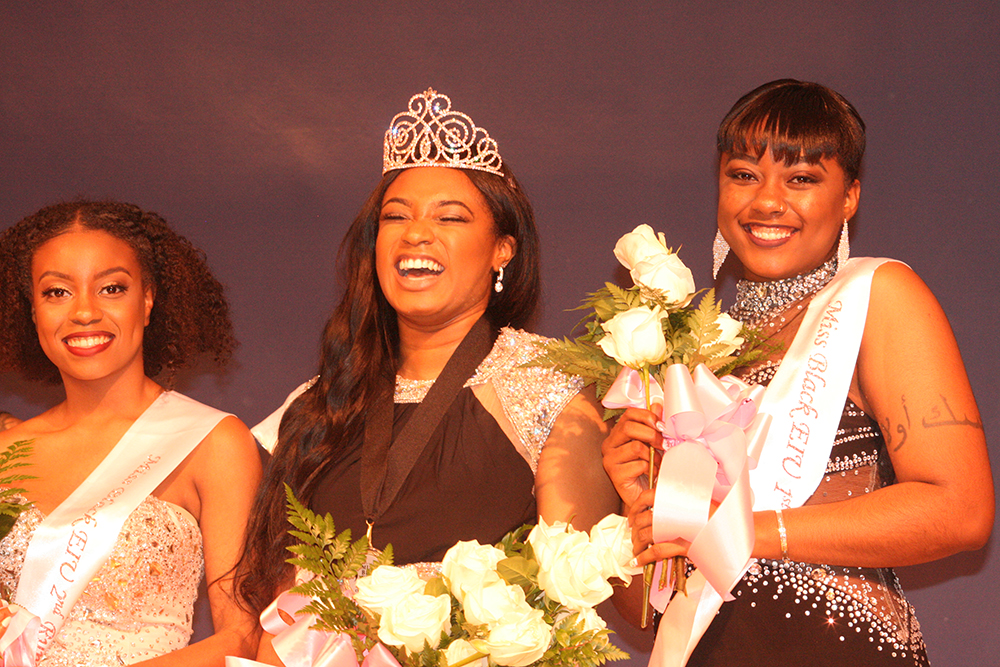 """Maxie Phillips (left),  a junior English major and the second runner-up for Miss Black EIU, Raven Gant (middle), a junior biological sciences major and winner of Miss Black EIU and Rajah Matthews (right), a sophomore kinesiology and sports studies major and the first runner-up for Miss Black EIU, pose after Gant was crowned Saturday night in the Grand Ballroom of the Martin Luther King Jr. University Union. After being crowned Miss Black EIU, Gant said she surprised herself with what she was able to accomplish. """"Me and all my sisters, we worked very hard. We stuck together through the entire process,"""" she said. """"I'm happy for each and every one of these girls, I know we all put in the effort. It's just a great experience."""""""