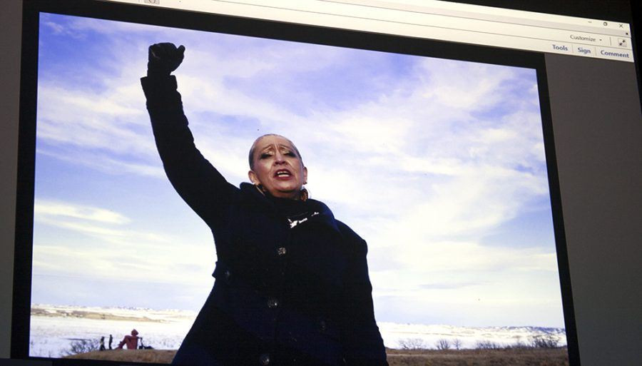 Olivia Swenson-Hultz | The Daily Eastern News A photograph by Alexandra McNichols-Torroledo features a leader at the resistance at Standing Rock, Ladonna, Brave Bull protesting with her hands up.