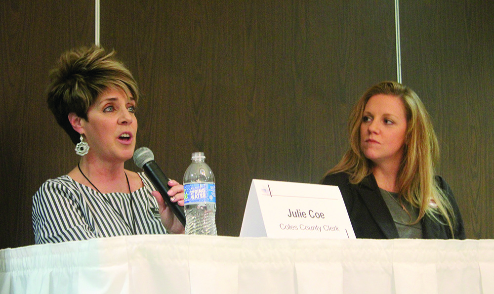 Coles County Clerk candidates Julie Coe and Jackie Freezeland answer questions regarding their campaigns Tuesday evening at the Unique Suites Hotel.