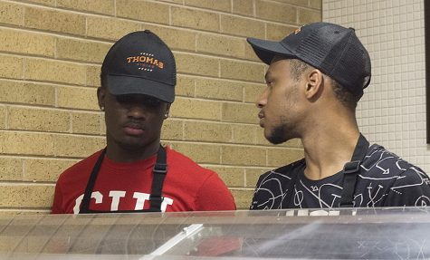Kaleb Simmons a junior computer and information technology major and a student worker for the Thomas Dining Center, talks to another student worker, Tahuan Williams, a freshman applied engineering major, Monday during Late Night Pizza. Simmons said he has only worked in the dining center for about a month and though the work is tedious, the hours are long and he has to stand most of the time, but it is a job that pays.
