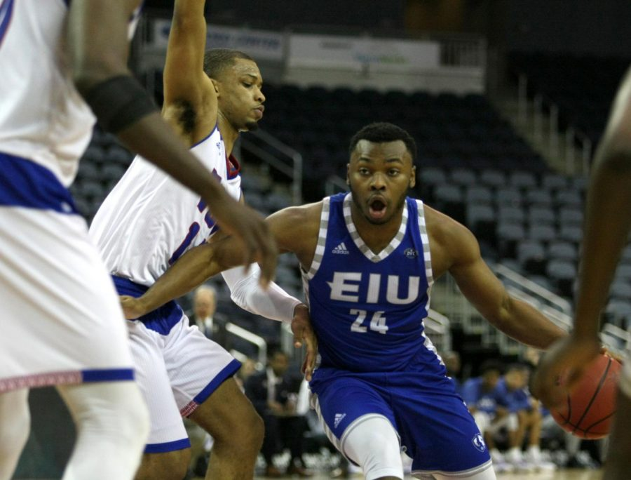 Junior Jajuan Starks dribbles past a Tennessee State defender in the second half of Eastern's 73-71 opening round win at the OVC tournament in Evansville, Indiana's Ford Center. Stark's came off the bench to score 8 points in an 2-for-3 effort from three point land.