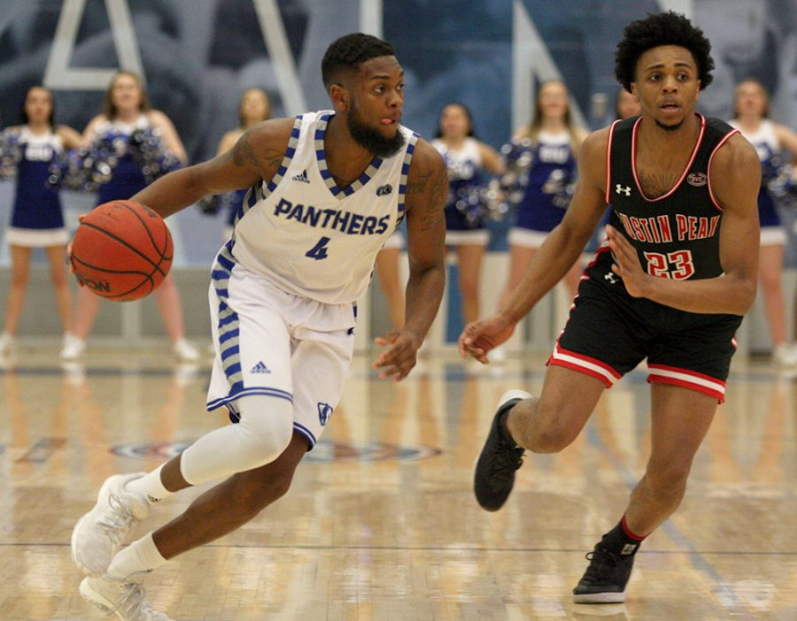 Senior Montell Goodwin dribbles past Austin Peay's Steve Harris in the Panthers' 76-69 loss Saturday in Lantz Arena. Eastern is seventh in the OVC.
