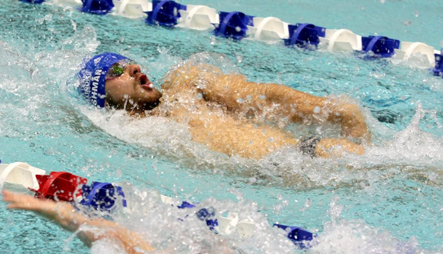 Senior Steve Fishman swims the backstroke in the Panthers' meet Oct. 28 against Western. Fishman broke the 100-yard individual medley Eastern record at the Summit League Championships with a time of 51.09. That time also earned him second place in the event.