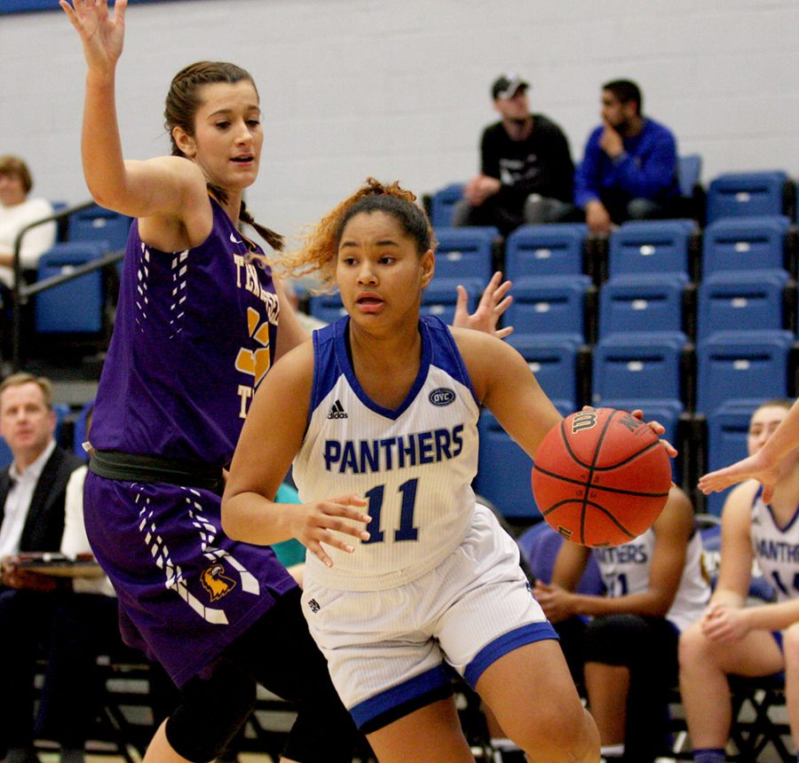 Freshman Karle Pace dribbles past Tennessee Tech's Mackenzie Coleman in Eastern's 60-57 loss Saturday in Lantz Arena. Pace finished with 18 points.
