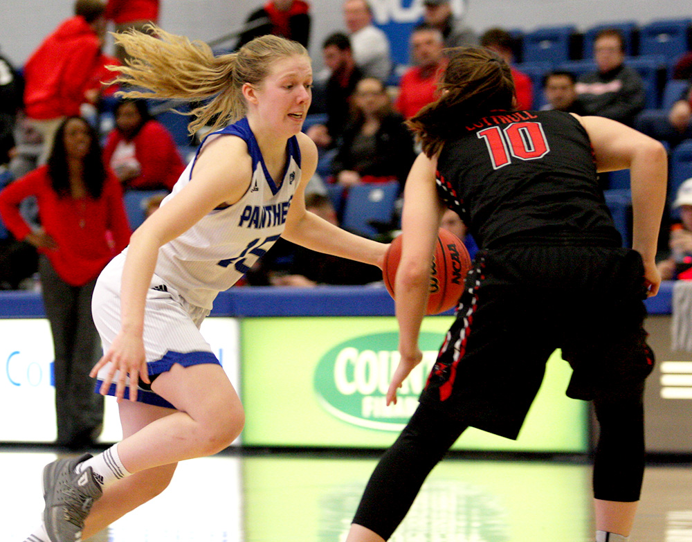 Freshman Taylor Steele makes a move just past half court to slip by an Austin Peay defender in Eastern's 75-66 loss Jan. 20 in Lantz Arena.