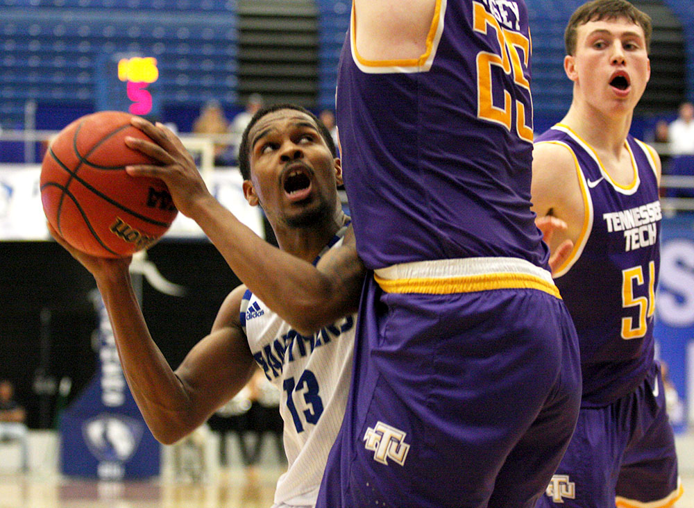 Redshirt junior guard throws up a layup high off the backboard at the end of the shot clock in Eastern's 79-71 win over Tennessee Tech Saturday in Lantz Arena. Wilson injured his left hand in the game and is out the rest of the season. He is the fourth point guard to be injured this year.