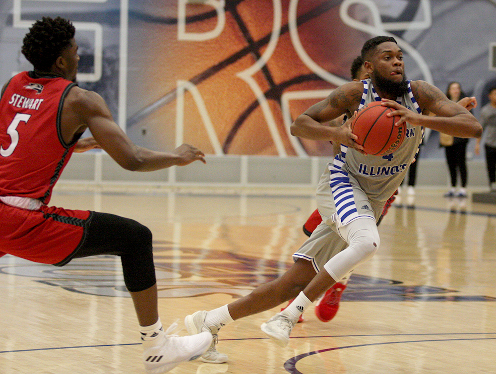 Senior Montell Goodwin steps past a Southern Illinois Edwarwdsville player in the Panthers' 68-56 win in Lantz Arena on Saturday. Goodwin finished the game on 12 points.
