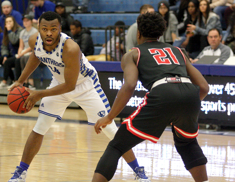 Junior Jajuan Starks handles the ball at the top of the arc in the Panthers' 76-69 loss to Austin Peay Saturday in Lantz Arena. Starks scored six points in the game.