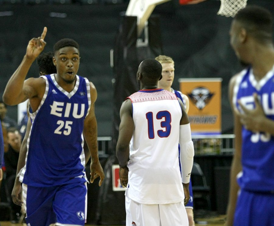 Muusa Dama celebrates Eastern's 73-71 win over Tennessee State during Wednesday's opening round of the OVC Tournament in Evansville, Indiana.