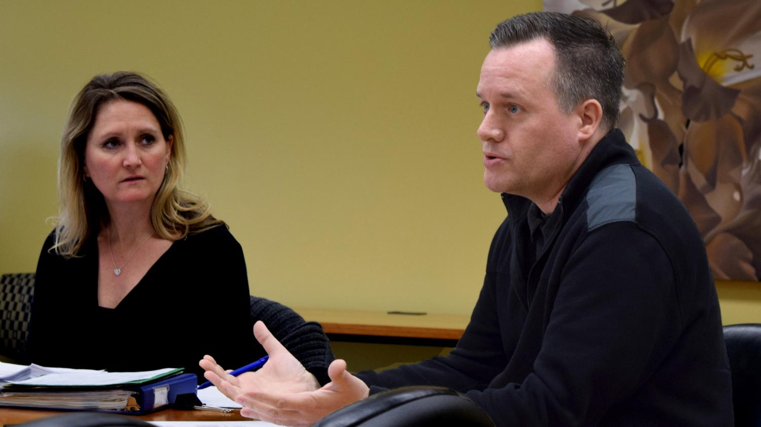 Stacey Ruholl, a kinesiology and sports studies professor and the Council on Academic Affairs chair, sits with Art Department Chair Chris Kahler Thursday afternoon in Booth Library. Kahler presented two revised majors and a revised minor to the CAA.