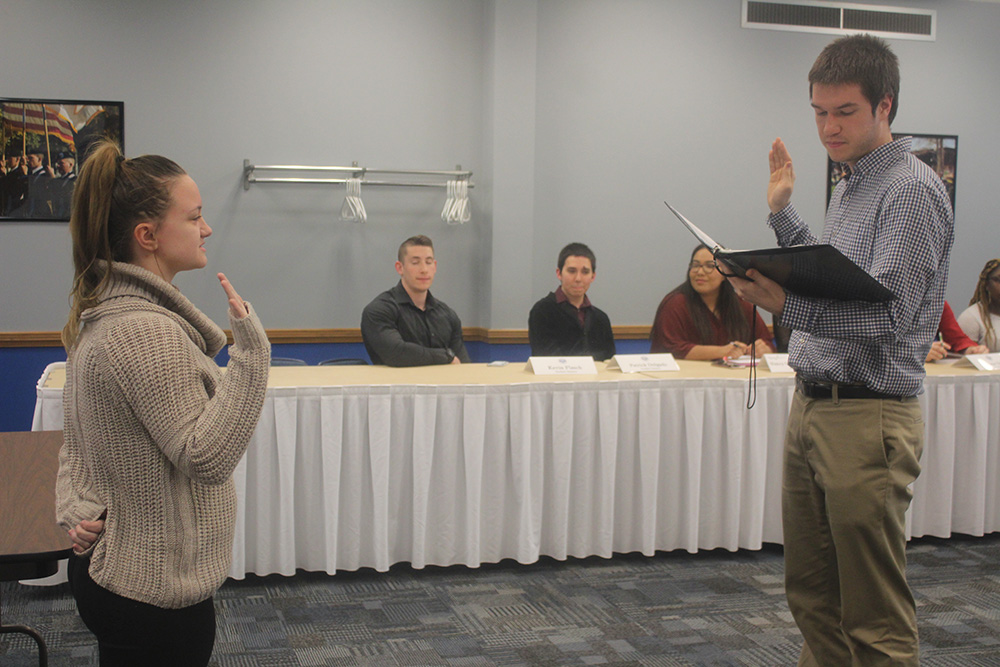 Maddie Tate, a freshman early childhood education major is appointed into Student Senate by the Student Body President Luke Young, at a meeting in the Arcola/Tuscola  room of the Martin Luther King Jr. University Union on Wednesday evening.