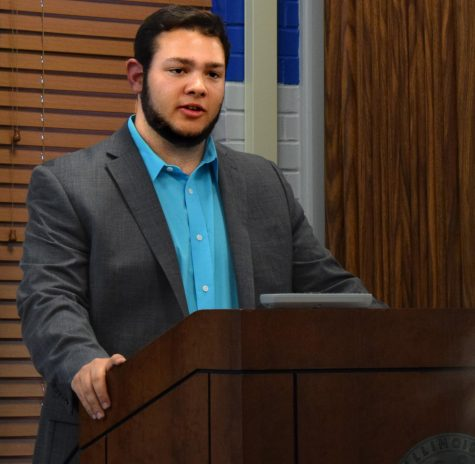 Zac Cohen, a sophomore accounting major and the student vice president for student affairs, peaks at the Student Senate Forum, Thursday evening in the Martin Luther King Jr. University Union. He is running uncontested for the position of executive vice president.