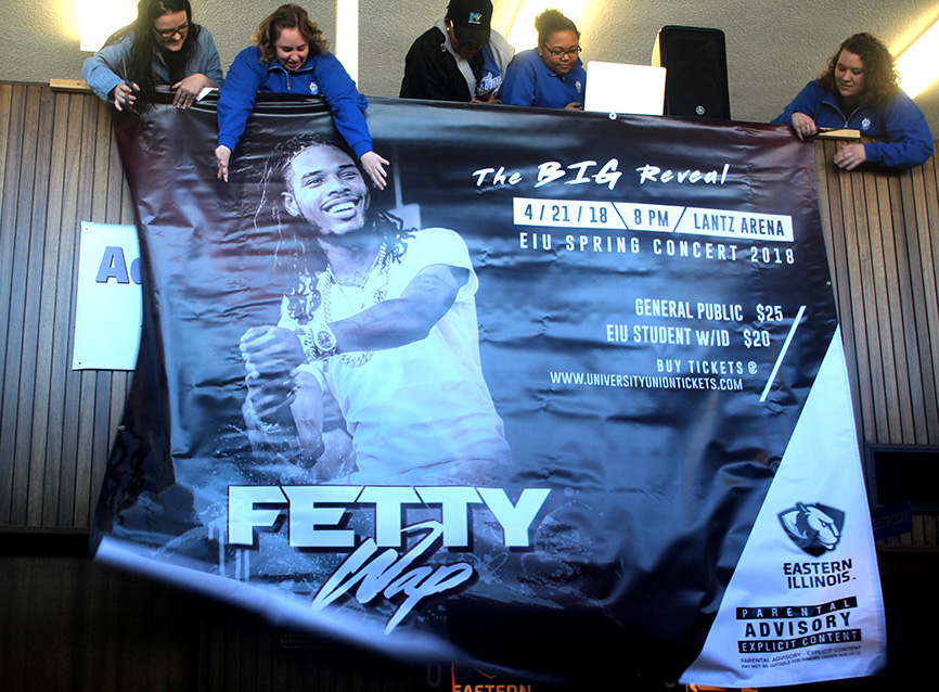Members of the University Board drop a banner revealing the name of rapper Fetty Wap, who will be performing at the Spring Concert at 8 p.m. on April 21 in Lantz Arena.