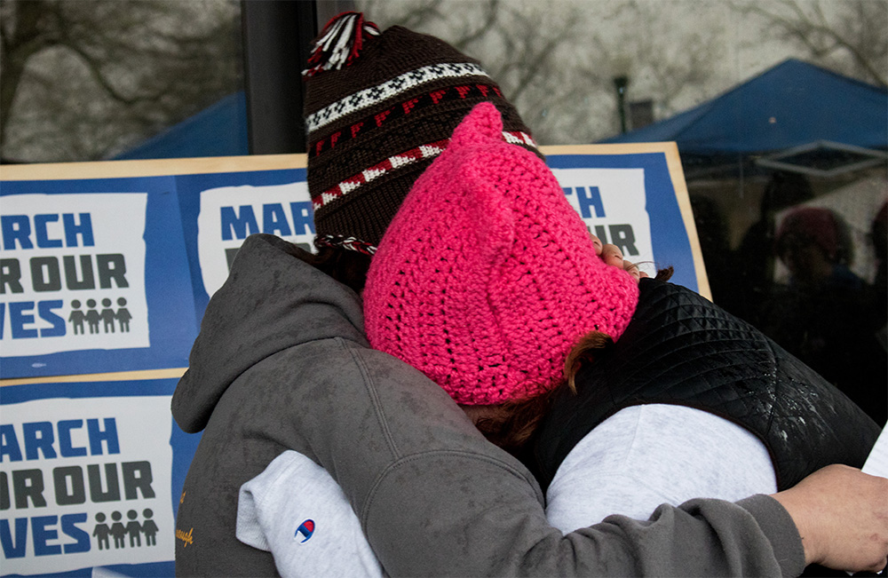 "Jennifer White hugs her daughter Zoey White, after she talked about her experience with the Mattoon High School shooting at ""March For Our Lives"" in the Library Quad on Saturday. Jennifer said it's easier to speak out for gun reform on campus because, campuses tend to be more liberal, while in Mattoon it's a different scenario. ""I was fortunate enough to not be there, but I do have friends who still have nightmares. No one deserves that,"" Zoey said during her speech."