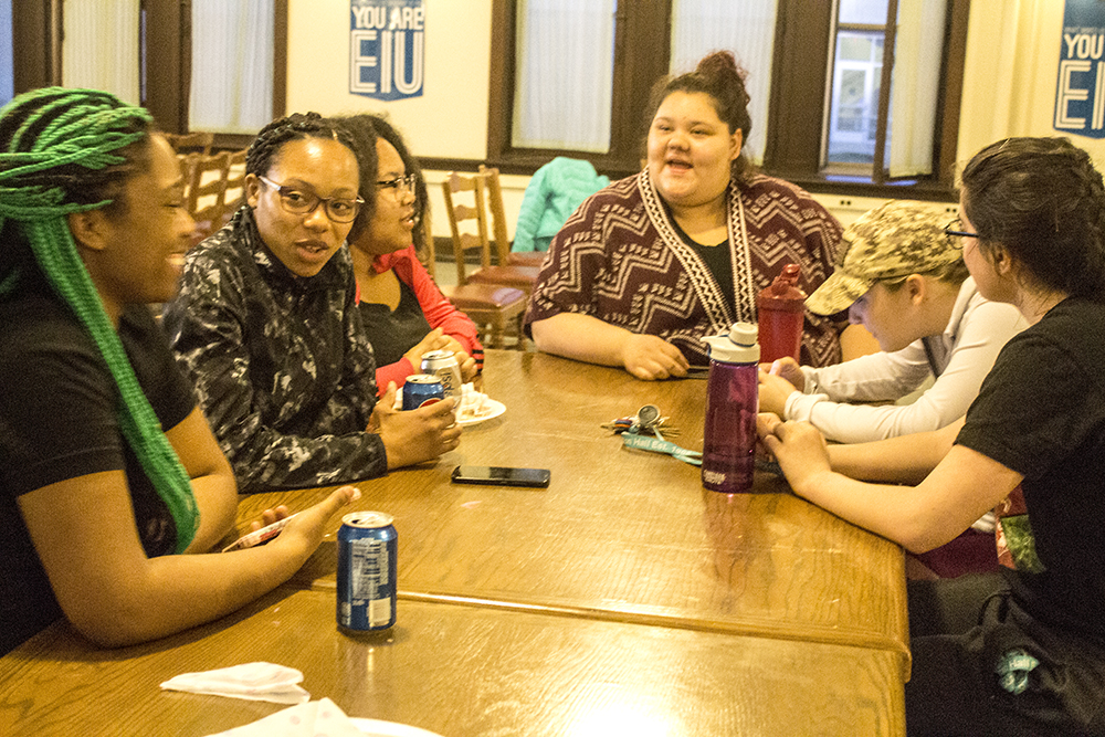 """Students socialize during the """"Hunger Banquet,"""" a meal meant to demonstrate hunger disparity."""