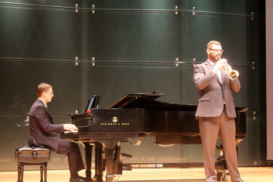 "Benjamin Hay and Jonathan Bowman perform ""Centennial Horizon"" on the piano and trumpet Monday evening."