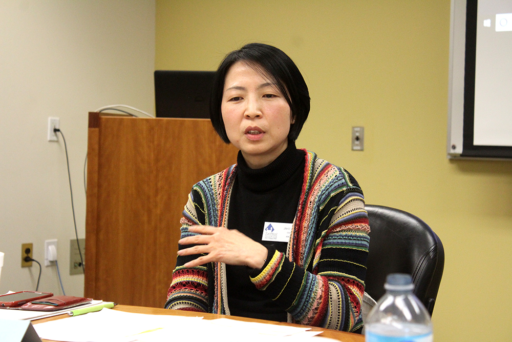 History professor Jinhee Lee discusses President Donald Trump's involvement with North Korea at a panel inside of Booth Library Monday.