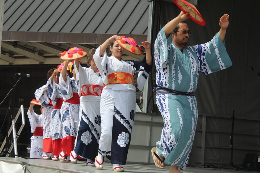 The Bon Odori group performs a Japanese dance for crowd members on Saturday during Celebration.