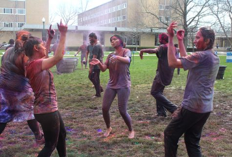 Students dance to traditional Indian tunes at Holi: the Festival of Colors on Saturday morning in the South Quad.