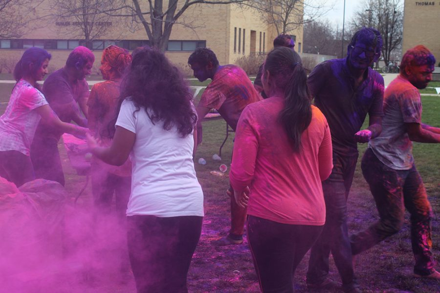 Students gather colors to throw at each other during Holi: Festival of Colors on Saturday in the South Quad.